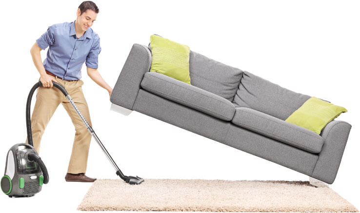 photo of a cleaner lifting a sofa to clean under
