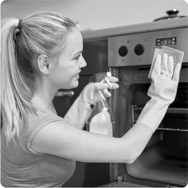 photo of a female cleaner putting on gloves