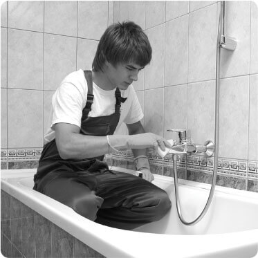 photo of a cleaner cleaning a bathroom