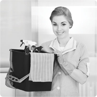 photo of a female cleaner getting ready for work