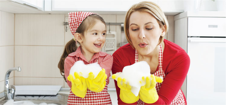photo of a female cleaner and her daughter holding clouds of foam in their hands
