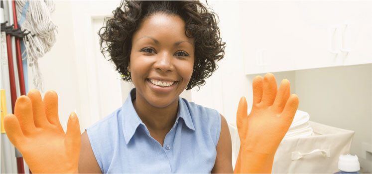 photo of a cleaner with her orange plastex gloves on