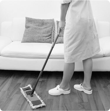 image of a cleaner mopping a floor